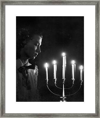 Woman And Menorah Framed Print by Underwood Archives