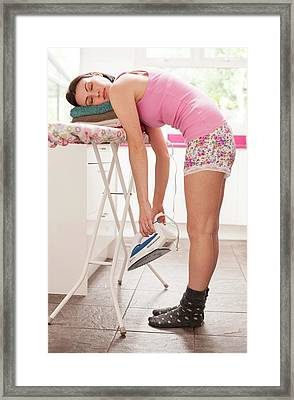 Woman Asleep On Ironing Board Framed Print by Ian Hooton
