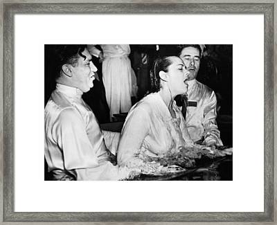 Woman Being Baptized Framed Print by Underwood Archives