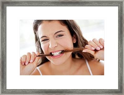 Woman Biting Her Hair Framed Print by Ian Hooton