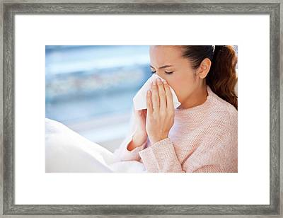 Woman Blowing Her Nose Framed Print by Ian Hooton