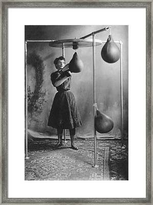 Woman Boxing Workout Framed Print by Underwood Archives