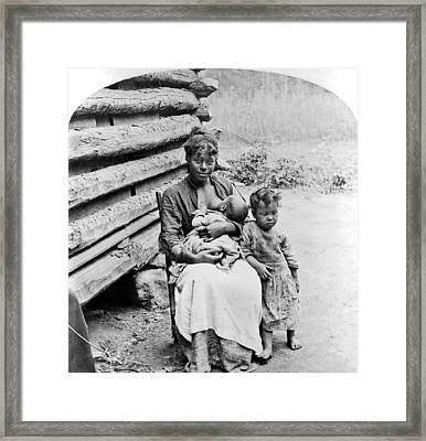 Woman Breast Feeding Her Baby Framed Print by Underwood Archives