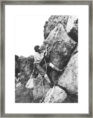 Woman Climbing In Zion Framed Print by Underwood Archives