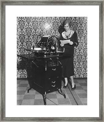 Woman Demonstrates Duplicator Framed Print by Underwood Archives