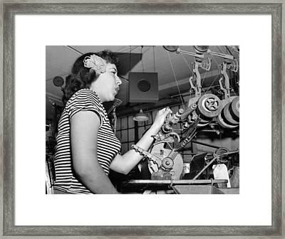 Woman Factory Worker Framed Print by Underwood Archives