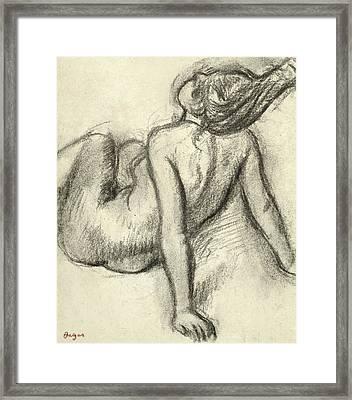 Woman Having Her Hair Styled Framed Print by Edgar Degas
