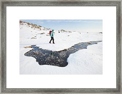 Woman Hill Walker By A Frozen Bog Framed Print by Ashley Cooper