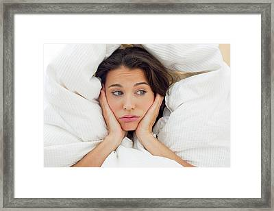 Woman In Bed With Hands On Chin Framed Print by Ian Hooton
