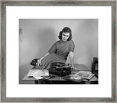 Woman Listening To Records Framed Print by Marguerite Baker Johnson