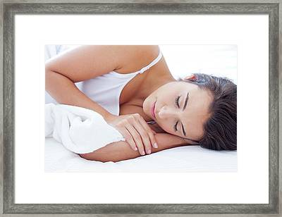 Woman Lying In Bed Asleep Framed Print by Ian Hooton