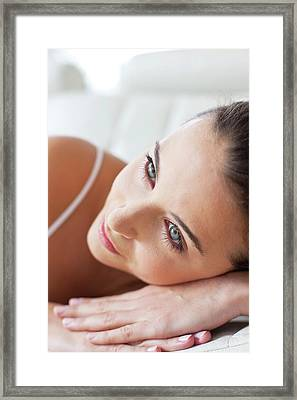 Woman Lying With Head On Hands Framed Print by Ian Hooton