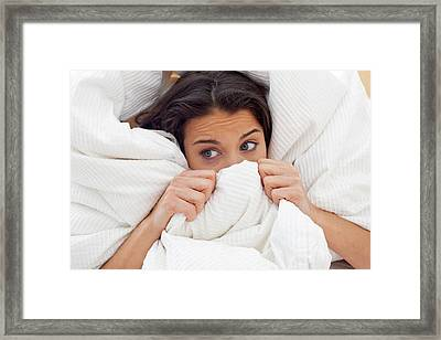 Woman Pulling Bedclothes Over Her Face Framed Print by Ian Hooton