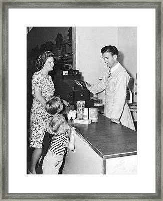 Woman Purchasing Groceries Framed Print by Underwood Archives