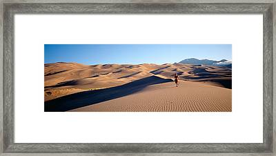 Woman Running In The Desert, Great Sand Framed Print by Panoramic Images