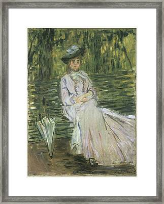 Woman Seated On A Bench Framed Print by Claude Monet