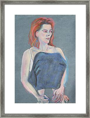 Woman Sitting With Her Skirt Covering Her Legs Framed Print by Asha Carolyn Young