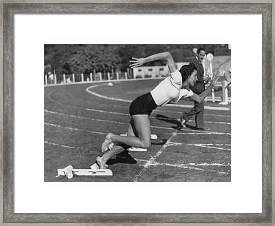 Woman Sprinter Framed Print by Underwood Archives
