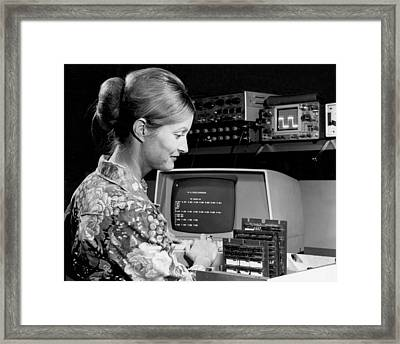 Woman Testing A Microcomputer Framed Print by Underwood Archives