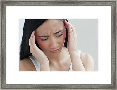 Woman Touching Head Framed Print by Ian Hooton