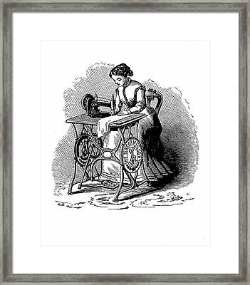 Woman Using Sewing Machine Framed Print by Universal History Archive/uig
