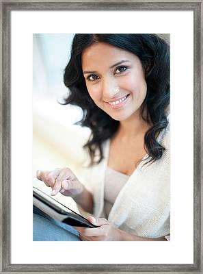 Woman Using Tablet Framed Print by Ian Hooton