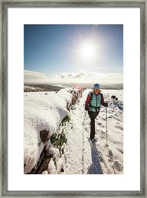 Woman Walking In Deep Snow Framed Print by Ashley Cooper