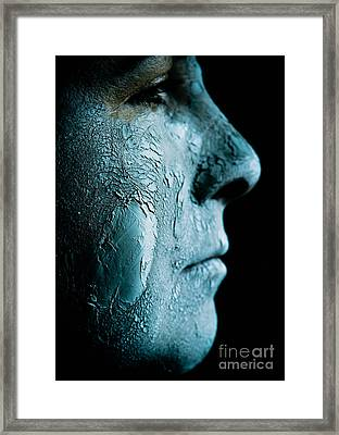 Woman Wearing A Green Mud Mask Framed Print by Amy Cicconi
