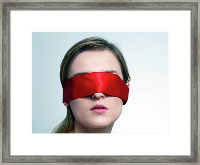 Woman Wearing Red Blindfold Framed Print by Victor De Schwanberg