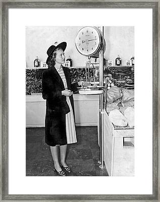 Woman Weighing Vegetables Framed Print by Underwood Archives