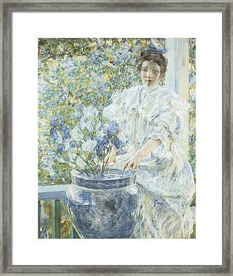 Woman With A Vase Of Irises Framed Print by Robert Reid