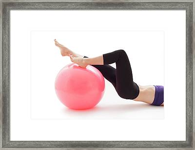 Woman With Fitness Ball Framed Print by Ian Hooton