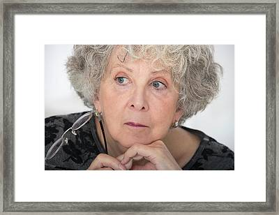 Woman With Grey Hair Holding Eyeglasses Framed Print by Lea Paterson