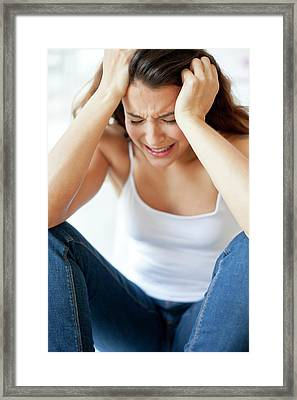 Woman With Hands In Hair Framed Print by Ian Hooton