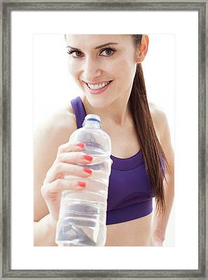 Woman With Water Bottle Framed Print by Ian Hooton