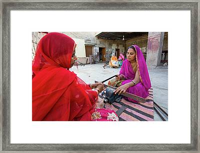 Women Constructing Solar Cookers Framed Print by Ashley Cooper