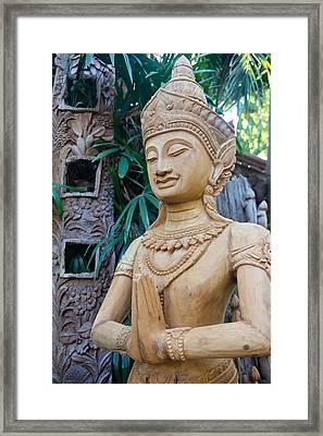 Wood Carving  Framed Print by Kobchai Sukruean