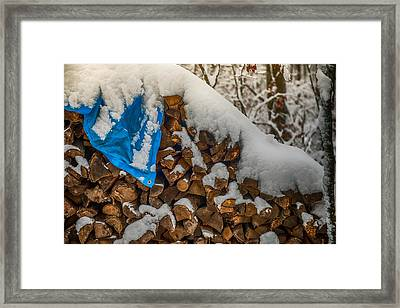 Wood Pile In The Snow Framed Print by Paul Freidlund