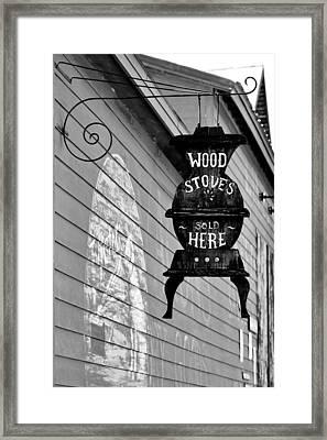Wood Stoves Sold Here Framed Print by Christine Till