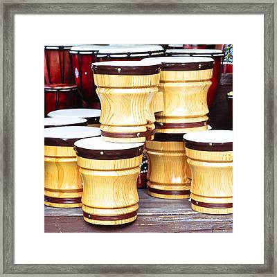 Wooden Bongos Framed Print by Tom Gowanlock