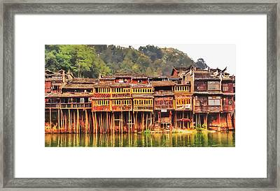 Wooden Houses Framed Print by Lanjee Chee