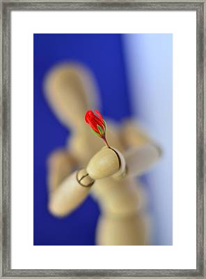 Wooden Man With A Flower Framed Print by Gynt