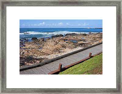 Wooden Promenade Along The Ocean In Porto Framed Print by Artur Bogacki