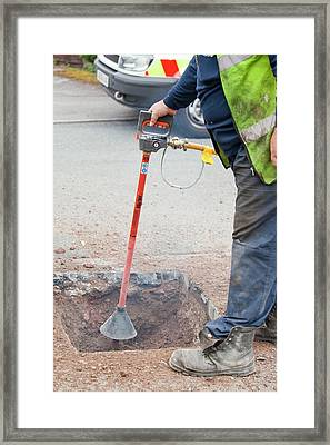 Worker Using A Compressed Air Soil Picker Framed Print by Ashley Cooper
