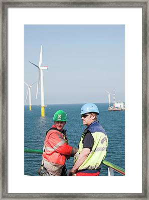 Workers On The Jack Up Barge Framed Print by Ashley Cooper