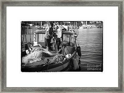 Working The Nets Framed Print by John Rizzuto