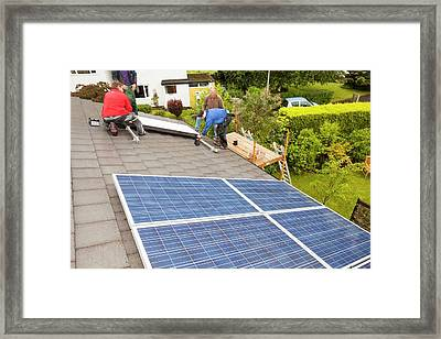 Workman Fitting Solar Thermal Panels Framed Print by Ashley Cooper