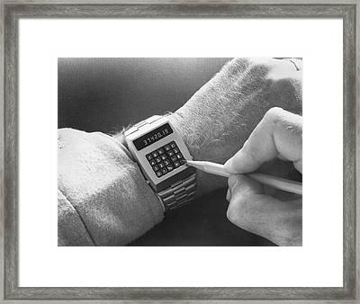 Wristwatch Calculator Framed Print by Underwood Archives