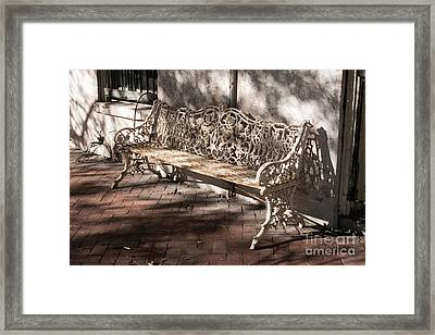 Wrought Iron Bench In White Framed Print by Jennifer Apffel