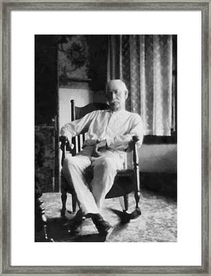 Wyatt Earp In A Rocking Chair Framed Print by Dan Sproul